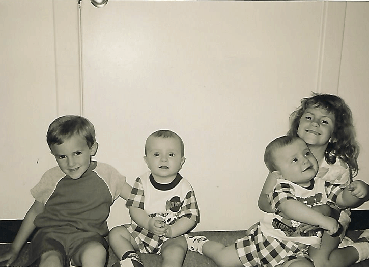 old photo of twin babies and two kids raise twins