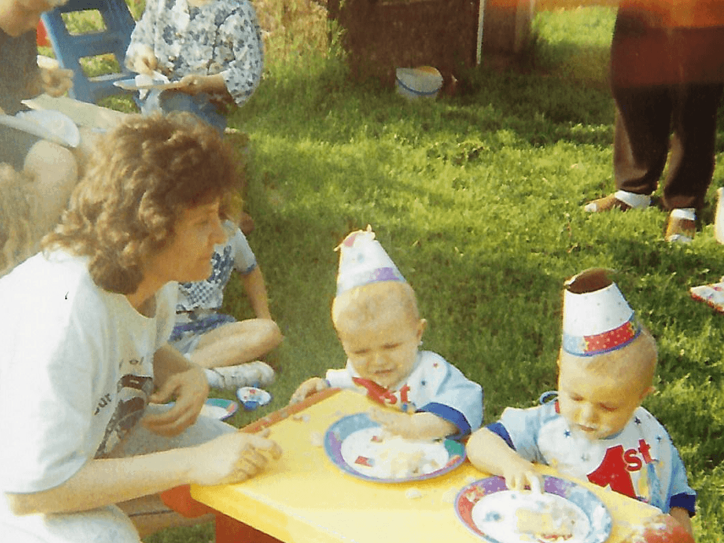 mom and twin babies at picnic table raise twins