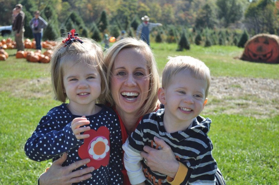 mom holding 3 year old twins third baby after twins