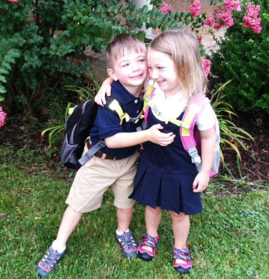 5 year old boy girl twins hugging wearing backpacks newborn twins