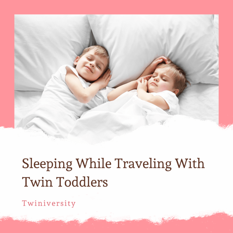 toddler twins sleeping on a bed