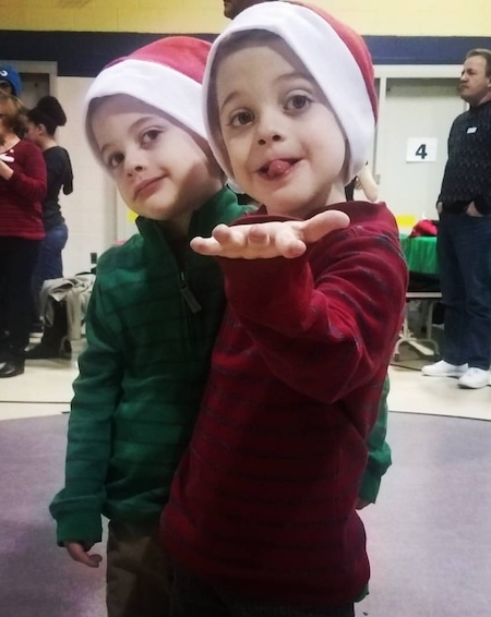 two young boy identical twins in Santa hats holiday memories
