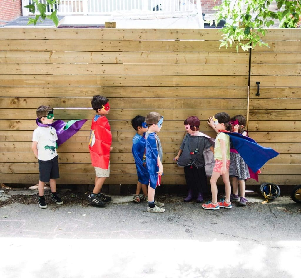 twins' birthday boys dressed up in capes and masks as a superhero costume