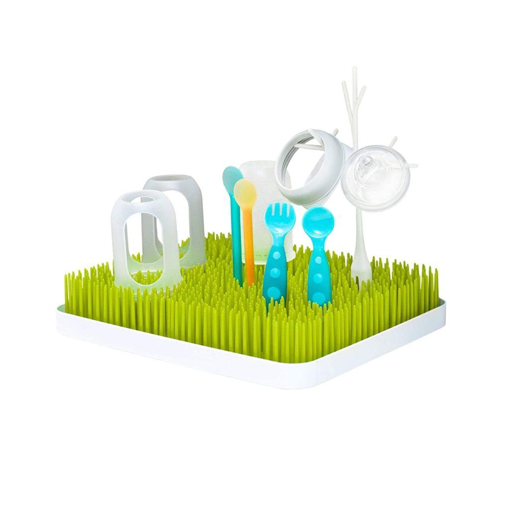 baby bottle drying rack green bottle rack with 2 bottles, nipples, and plastic toddler utensils