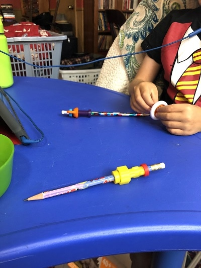 remote learning space hands holding fidget toys