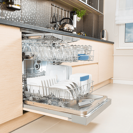 baby bottle drying rack opened dishwasher in a kitchen full of white and glass dishes