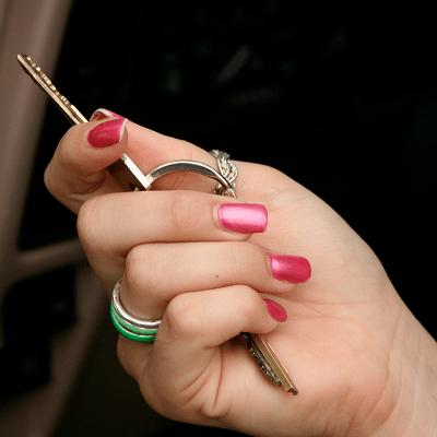 teen driver holding car keys