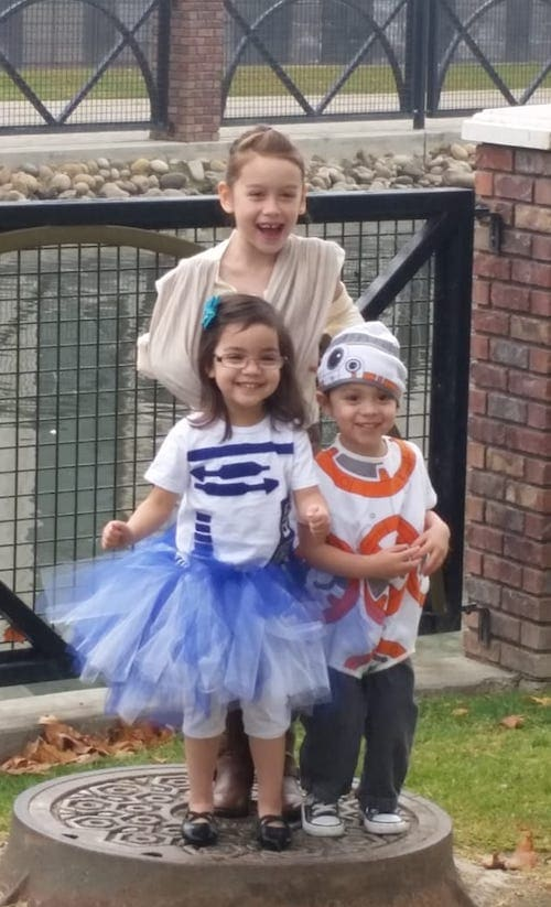 kids dressed as Rey, BB-8, and R2D2 from Star Wars boy girl twin halloween costumes
