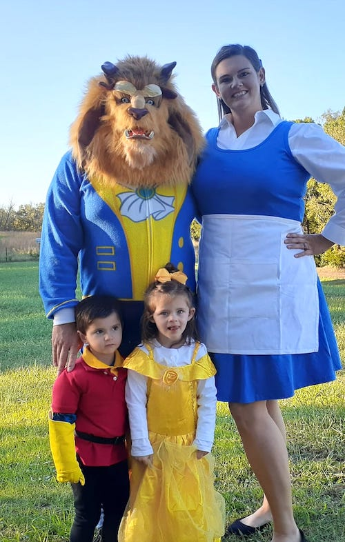 family dressed as Beauty and the Beast characters boy girl twin halloween costumes