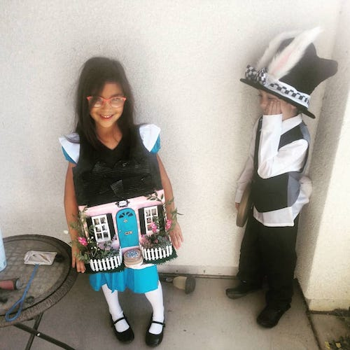twins dressed as Alice in wonderland characters boy girl twin halloween costumes