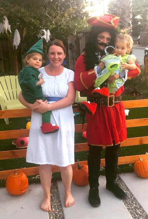 family with twins dressed as Peter Pan characters boy girl twin halloween costumes