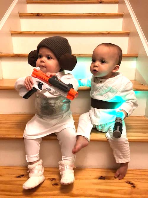 twin toddlers dressed as Luke and Leia boy girl twin halloween costumes