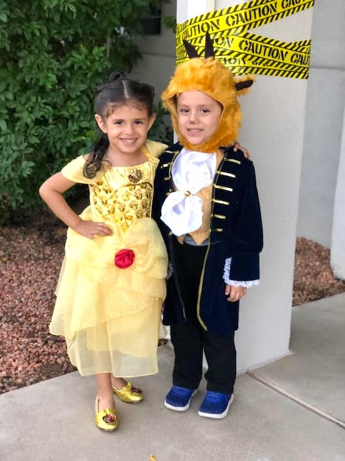 twins dressed as beauty and the beast boy girl twin halloween costumes