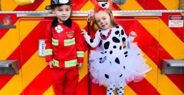 twins dressed as fireman and Dalmatian boy girl twin halloween costumes