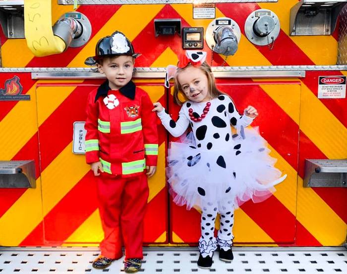 twins dressed as fireman and Dalmatian boy girl twin halloween costumes