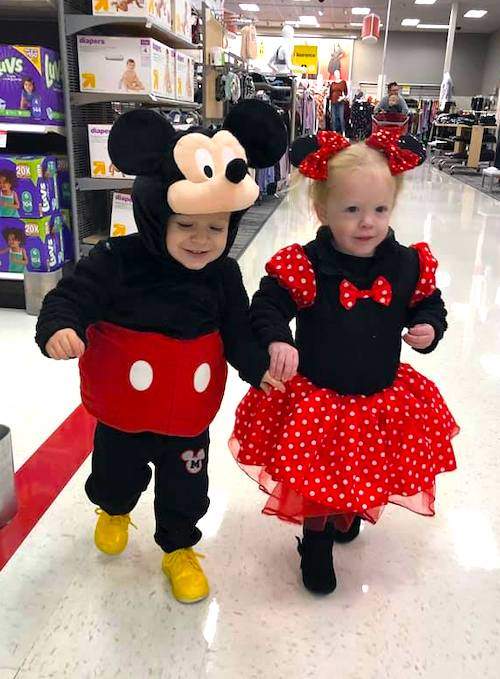 twin toddlers dressed as Mickey Mouse and Minnie Mouse boy girl twin halloween costumes