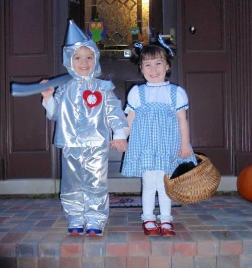 twins dressed as Dorothy and the tin man from the wizard of oz boy girl twin halloween costumes