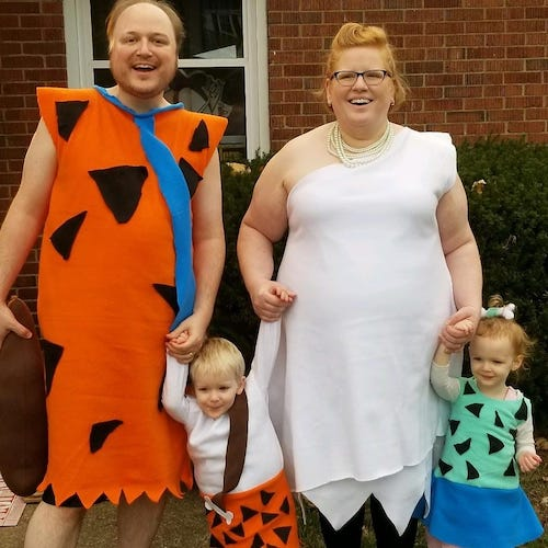 family dressed as the Flintstones boy girl twin halloween costumes