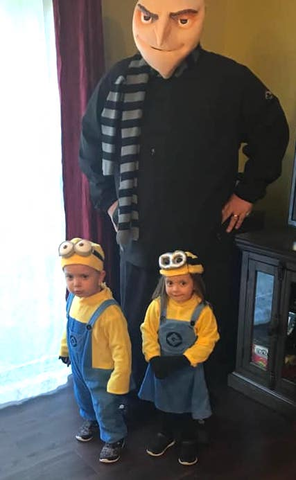 twin toddlers dressed as minions from despicable me boy girl twin halloween costumes