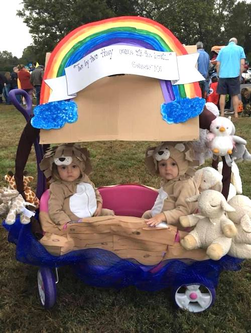 toddler twins dressed as animals in a wagon dressed as Noah's ark boy girl twin halloween costumes