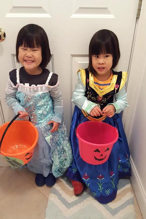 twin girls dressed as Anna and else from frozen trick or treating covid