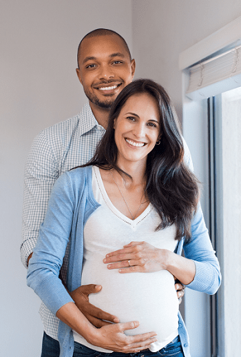 twins ultrasound pregnant woman and partner holding her belly