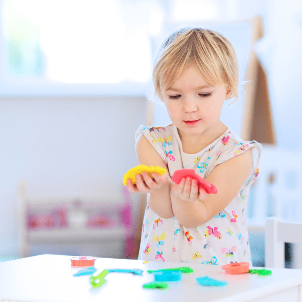 play centers girl with Play-Doh