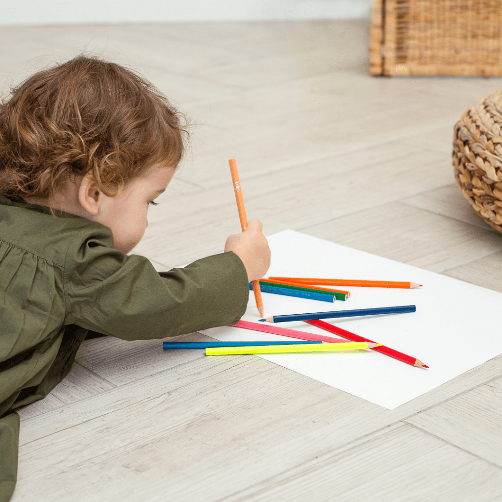 Play centers baby coloring with colored pencils