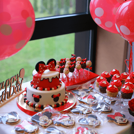 twins' birthday mickey and minnie mouse themed table with cake, cupcake, cookies, cake pops