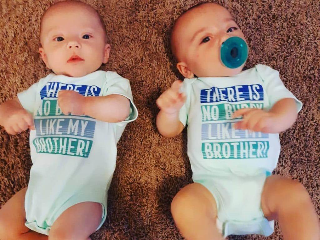 baby twins lying on the rug dressing twins alike