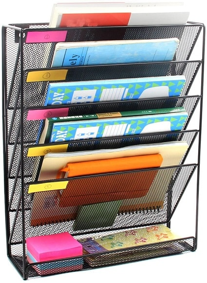 remote learning space hanging wall file holder willed with books and papers