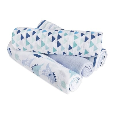 stroller blanket 4 rolled up swaddle blankets stacked on top of each other with different shades of blue and dinosaur prints