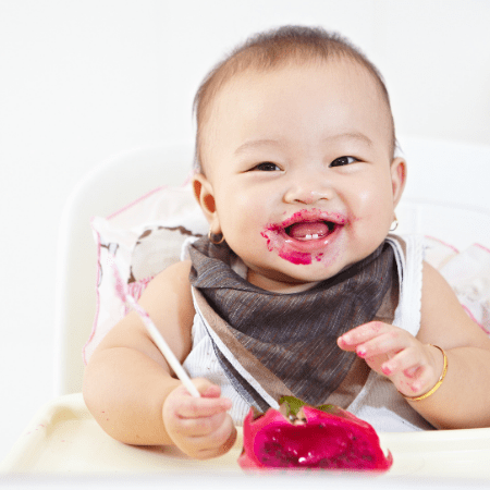 Food Allergies for Babies baby eating in a high chair