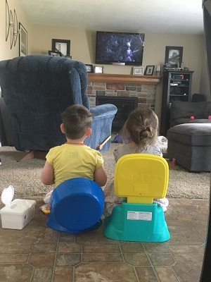 potty training regression boy/girl twins watching tv while sitting on potty seats