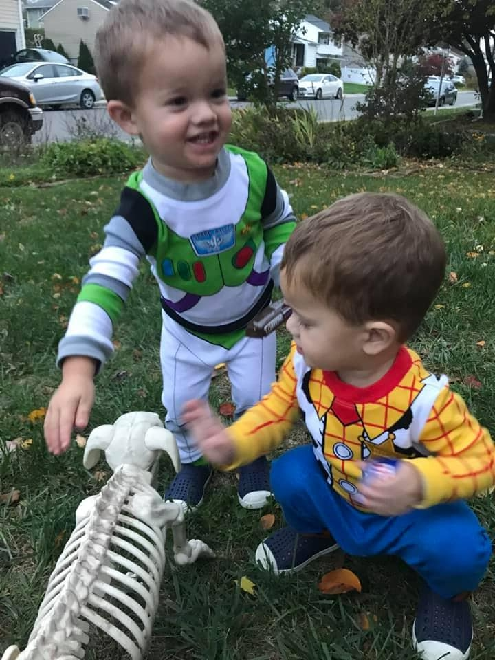 twins dressed as buzz and woody from toy story twin boys halloween costumes
