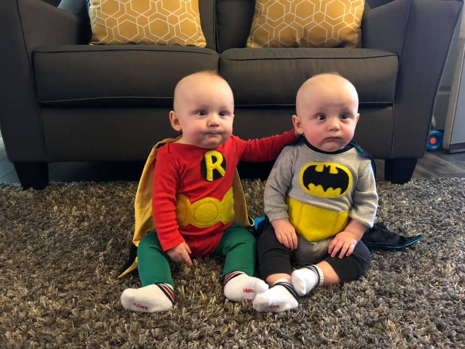 twin toddlers dressed as batman and robin twin boys halloween costumes