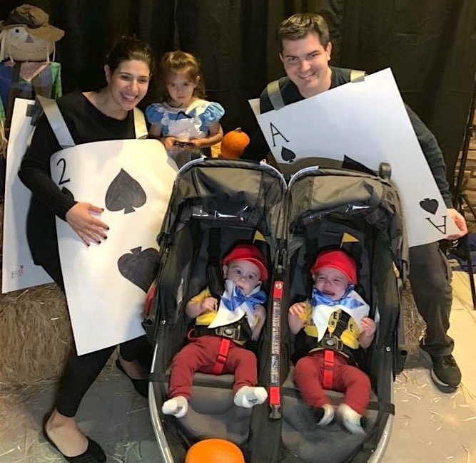family dressed as alice in wonderland characters twin boys halloween costumes