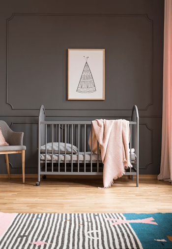 crib mattress dimensions A rug, chair and crib with a mattress in a room with a photo hanging above it on the wall