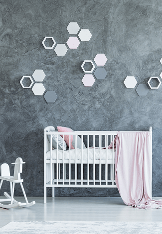 crib mattress dimensions crib with bedding and a small white rocking horse against a dark grey textured wall