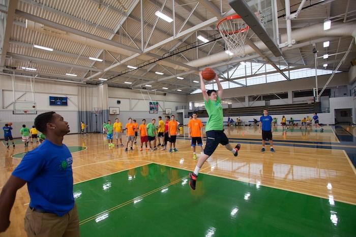 world sports camp kids playing basketball