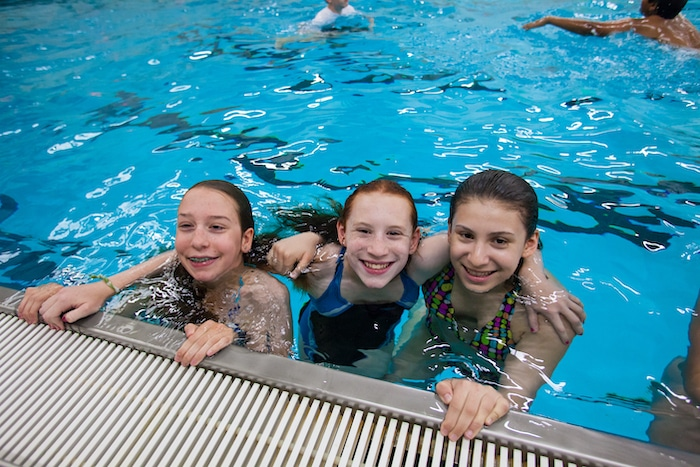 world sports camp girls in a swimming pool