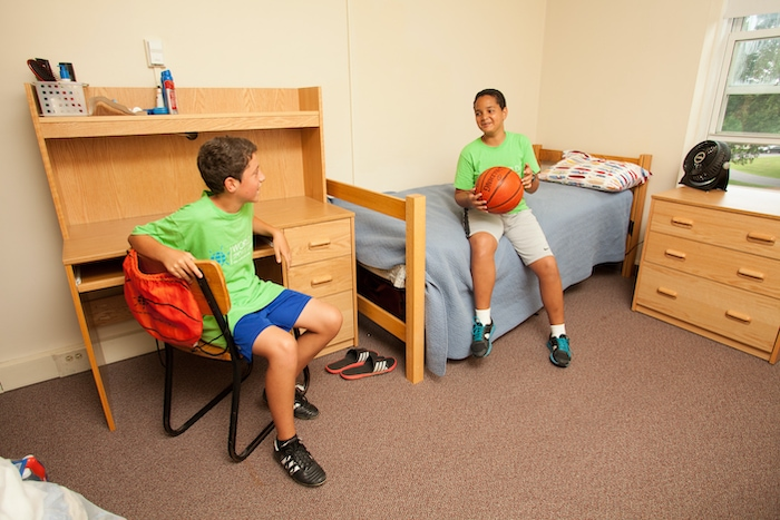 world sports camp boys in a dorm room