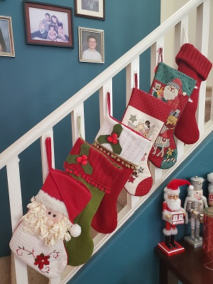 holiday season 6 Christmas stockings hanging from a railing