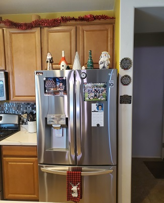 holiday season a refrigerator with Christmas decor on it
