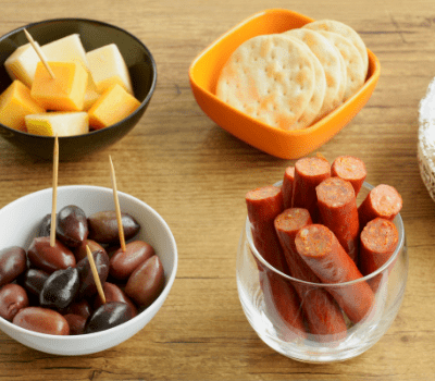 small portions of snack foods in bowls on a table