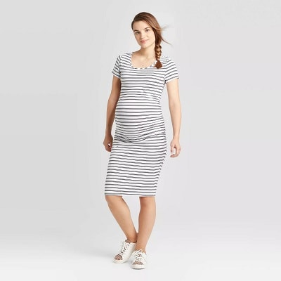 maternity baby shower dress pregnant woman in a black and white striped dress