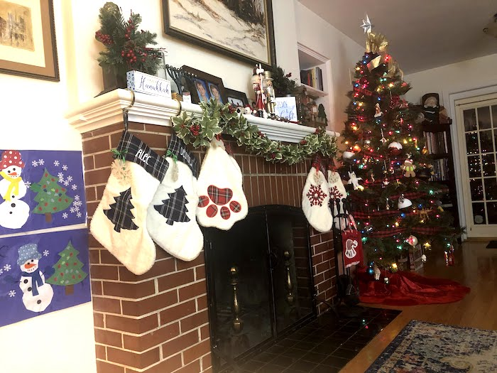 holiday safety tips fireplace mantel decorated for Christmas and Hanukkah