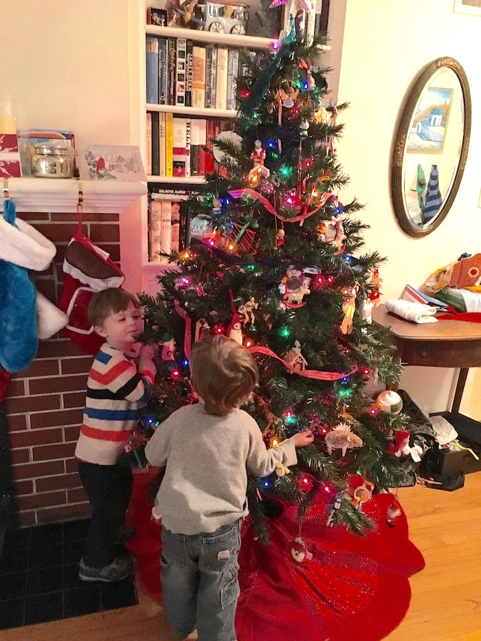 holiday safety tips kids looking at a Christmas tree
