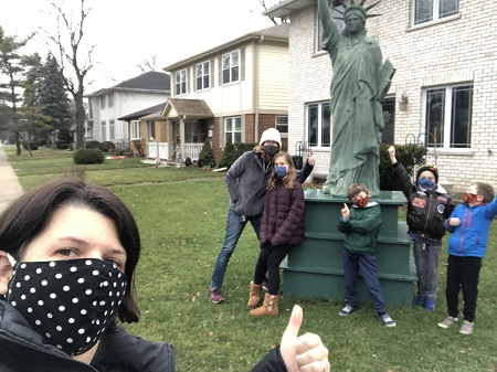 higlights of 2020 a masked woman taking a selfie with a group of masked children in front of a statue