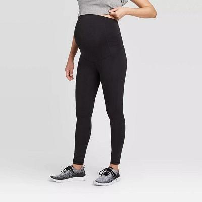 maternity leggings. a pregnant woman wearing black leggings